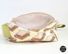 """""""Sexy Sandwiches"""" travel/toiletry bag new in the shop! Exterior fabric is a cotton canvas with an original illustration of sandwiches interior of bag is lined with wipe-able PUL fabric. More coming to the shop this week! http://ift.tt/2aY2EBK #HeartsAndSharts #CuteShit"""