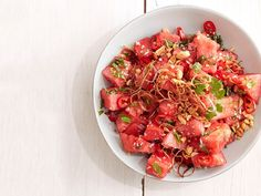 Prepare this simple, sweet-salty Asian Watermelon Salad by tossing cubed watermelon with shallots, lime juice, fish sauce, soy sauce, ginger and jalapeno.