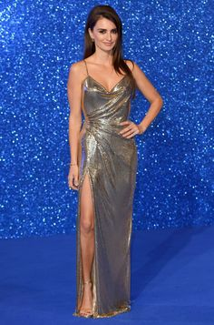 4 February Penélope Cruz pulled out all the stops at the Zoolander 2 premiere in London, wearing a shimmering gold Atelier Versace gown with thigh-high split.   - HarpersBAZAAR.co.uk