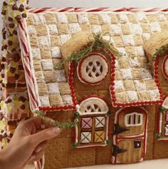Gingerbread House I use to make these too only miniature versions. You can glue graham crackers together with royal icing, and use shreaded wheat for the roofs.  You can easily find templates for these on the interenet.
