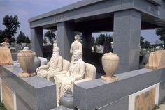 After John Milburn's wife Sarah died in 1930, John wanted to be rid of all his money. He commissioned an elaborate series of statues of himself and his wife in various scenes of their lives together for her grave. The sculptures, in a cemetery in Hiawatha, Kansas cost $200,000.
