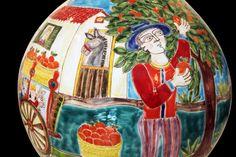 An incredible piece of art rapresenting scenes of Sicilians picking oranges.
