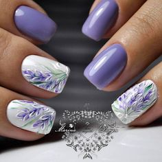 Beautiful nail Art with flowers in purple