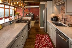 Downtown Des Moines loft kitchen remodel designed by Silent Rivers Industrial Cafe, Industrial Windows, Industrial Restaurant, Industrial Apartment, Industrial Bedroom, Industrial Interiors, Industrial Shelving, Industrial Furniture, Urban Industrial