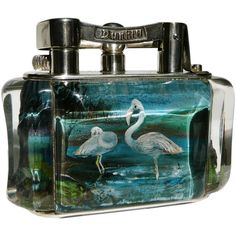 Alfred Dunhill 'Flamingo' Aquarium table lighter. England. Circa 1950s.  'Aquarium' lighters were all designed & hand-made by Ben Shillingford (1904-2000), whose unique skills in designing, carving and hand-painting the Perspex panels could never be equaled.         No two 'Aquarium' lighters are the same – each is, in its way, a unique work of art.