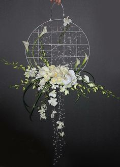 Very Interesting design, a lovely piece for Ceremony backdrop or is it a Bridal Bouquet? Stunning.