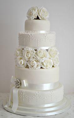Ivory wedding cake. Simple and elegant.