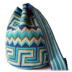 $89.90-$92.90 #Wayuubags. Large Wayuu bag are your go-to comfortable cross-body bags for the beach and the city. You can't have just one! All Wayuu bags come with a handwritten postcard, and little gift. The time required to elaborate a Wayuu Mochila varies from 10-15 days. www.lombiaandco.com Crochet Handbags, Tapestry Crochet, Little Gifts, Vivid Colors, Cross Body, Free Crochet, Free Pattern, Crochet Patterns, Crossbody Bag