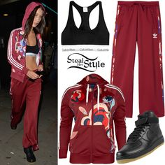 Bella Hadid was spotted arriving at Heathrow Airport last week wearing a Hooded Track Jacket (£54.95) and Sailor Pants ($75.00) both by Adidas Originals X Rita Ora, a Calvin Klein Modern Cotton Blend Racerback Bralette ($28.00) and Nike Air Force 1 Mid Gum Shoes ($94.99 – all black).