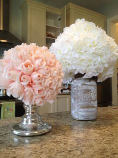 Another centerpiece idea I made using a Mason jar (painted inside) and candal holder as flower ball bases