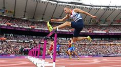 David Greene of Great Britain competes in the Men's 400m Hurdles Heats on Day 7 of the London 2012 Olympic Games at Olympic Stadium.