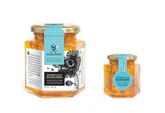 Great labeling concept for honey products in glass hex jars. We've got the jars and the design know-how to build something like this for you. http://www.containerandpackaging.com/catalog/hex-glass-jars/75/