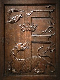 A French carved-oak panel, c.1520-40, decorated with a crown, 'F' and salamander engulfed in flames, the emblems of King François I of France; sonsidered impervious to fire, the salamander symbolised the king's constancy and integrity as a ruler. (Metropolitan Museum of Art)