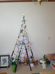 My brother's fishing pole christmas tree with picture of  his dog.