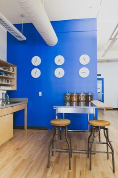 Ripple's logo colors work as a theme pulling together this sleek startup's office design.