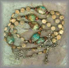 www.rosaryworkshop.com  for information on this designer rosary.