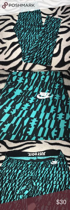 Brand new NIKE leggings Super cute blue and black. brand new Nike leggings with Nike all over them! I bought them, took the tags off and never wore them because I have the same ones in black and white! Size M! They are Long leggings go all the way down to the ankle Nike Pants Leggings