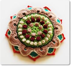 Made by layering crochet motifs