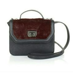 """HP  BCBGeneration Landon Icon Shoulder Bag Over the shoulder essentials holder. Arm yourself with this iconic handbag and go from work to weekend without missing a stylish beat. Dark radpberry color. Approx. 8""""L x 3""""W x 7""""H with a 1-3/4"""" top handle and a 21"""" shoulder strap. BCBGeneration Bags Shoulder Bags"""
