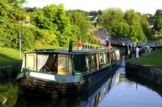 Luxury Canal Boat in Bath, England. A great way to tour England...by the vast canal system and convenient country pubs along the way! A must do for anyone looking for a different kind of vacation :)
