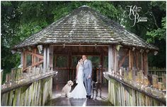 Rainy Wedding at Alnwick Gardens Treehouse Restaurant, the bride and groom also had their dogs at their wedding.