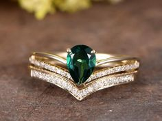 lab treated emerald engagement ring set white gold diamond wedding band bridal ring set curved V band pear cut Emerald by rststudio on Etsy Bridal Rings, Wedding Rings, Mothers Day Rings, Gold Diamond Wedding Band, Emerald Jewelry, Diamond Cluster Ring, Emerald Diamond, Engagement Ring Settings, Emerald Engagement Rings