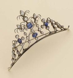 A petite diamond and sapphire tiara, circa 1880. Designed as a series of gold open work scrolls, embellished with circular diamonds and four Ceylon sapphires, topped with three pear-shaped diamonds. Sold by Christie's for an undisclosed sum.