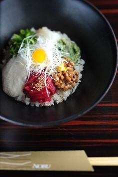 Rice topped with beans, umeboshi, green onions, seaweed, egg...