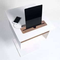 Using an integrated charging station, Spell's Nomad nightstand table lets you charge your smartphone and tablet when you finish your bedtime reading, and decent