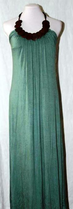 Soft green maxi dress with wooden necklace