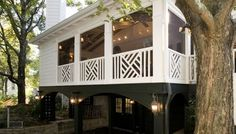 Chippendale railing on screened porch with carport below. Photo courtesy of The Porch Company in Nashville.