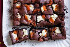 Dollop spoonfuls of ricotta, apricot and hazelnut over fudge chocolate cake.