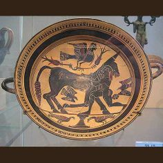 Ancient Greek pottery kylix, or drink cup, in the style of the Arkesilas Painter.