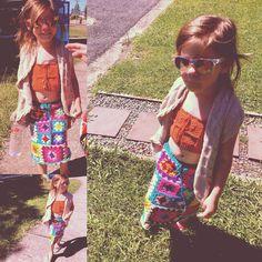 My awesome crochet child. Amala rocking my crochet festival crop top & skirt.