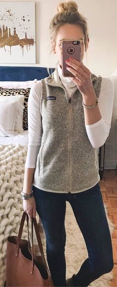 #winter #outfits white top, beige vest, jeans, brown bag