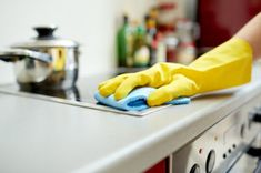 Photo about People, housework and housekeeping concept - close up of woman hand in protective glove with rag cleaning cooker at home kitchen. Image of kitchen, cooker, chores - 51933872 Steam Cleaning, House Cleaning Tips, Cleaning Hacks, Cleaning Agent, Domestic Cleaning Services, Dirty Kitchen, Professional Cleaners, Kitchen Images, Kitchen Ideas