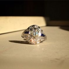 Platinum & 0.42ct Diamond Engagement Ring with French Cut Sapphire Accents, Circa 1920.