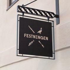 Logo and exterior sign aged designed by Uniform for Oslo brasserie Festningen