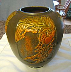For sale online at More Than McCoy on TIAS; antique Roseville Pottery Panel vase c:1920.