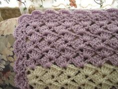 lavender shell afghan: love the stitch. thinking black & brights w/ lots of change-up would be kewl :)