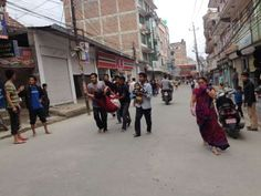 Earthquake in Nepal 2015 - Rescuers scurry to get an injured woman to a medical facility. - n - Guna Raj Luitel via AP