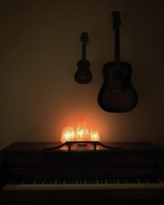 Glowing salt lamp instrument wall with piano, guitar, and ukulele
