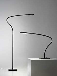 Paraph, Table Lamp and Floor for direct light designed by Serge & Robert Cornelissen in 2011 and produced by Prandina. Structure: bent aluminium painted in matt black. LED tilting head with PMMA optic lens, in anodized aluminium. 360° revolving structure. LED version: dimmable on request. Interior Lighting, Lighting Design, Street Light Design, Luminaire Mural, Italian Lighting, Desk Lamp, Table Lamps, Lamp Light