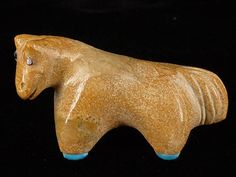 Our fetishes are handmade in New Mexico by Native American artists.  This marvelous little horse fetish was made from Zuni stone (travertine) by Zuni carver Hayes Leekya. Hayes is the grandson of Leekya Deyuse, one of Zunis most prominent fetish carvers (1889- 1966). The horse represents partnerships and strength. He also represents power and expanding ones abilities. The horse has innate healing powers. Hayes has followed in his grandfathers footsteps and has carved turquoise hooves on this…