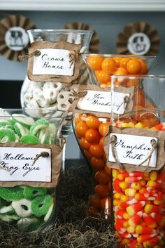 """I started out this whole Halloween idea with this fun table candy display! It's a great way to bring color, and maybe a little """"ew"""" factor into Halloween, with fun homemade labels and some creative new candy titles :) Dulces Halloween, Fröhliches Halloween, Adornos Halloween, Spooky Halloween Decorations, Halloween Goodies, Halloween Food For Party, Holidays Halloween, Halloween Treats, Classy Halloween"""