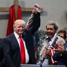 Boxing promoter #DonKing holds up #DonaldTrump's hand during a visit to the…