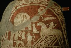 Odin rides his eight-legged horse Sleipnir. Valkyries guard the gates to Valhalla. These pictures were carved on a stone in the AD 700s.