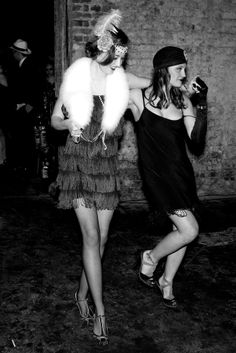Flappers at a club in London, England. Flappers had their origins in the liberal period of the Roaring Twenties, the social, political turbulence and increased transatlantic cultural exchange that followed the end of World War I, as well as the export of American jazz culture to Europe.