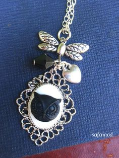 Nice necklace that consists of a silver holder, 32 mm x 25 mm oval cabochon owl owl white black resin connector butterfly, heart charm, pearl top, all mounted on silver chain.    Sending in   Organza bag and under bubbles.    ------ Ring matched sale on my shop.