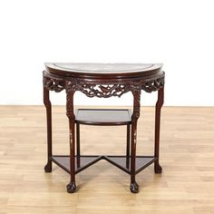 This end table is featured in a solid wood with a glossy rosewood finish. This Asian style side table has intricately carved bird and dragon motifs, beautiful inlaid mother of pearl top, and 3 bottom tiers. Perfect as an entryway table! #asian #tables #endtable #sandiegovintage #vintagefurniture